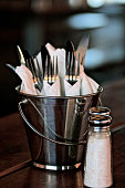Forks and Knives in bucket