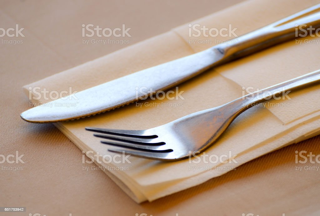 Fork and knife restaurant table set stock photo