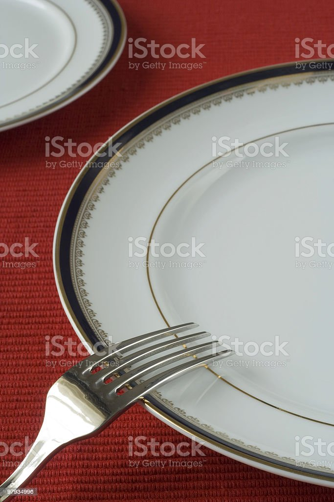 fork and plates in perspective royalty-free stock photo