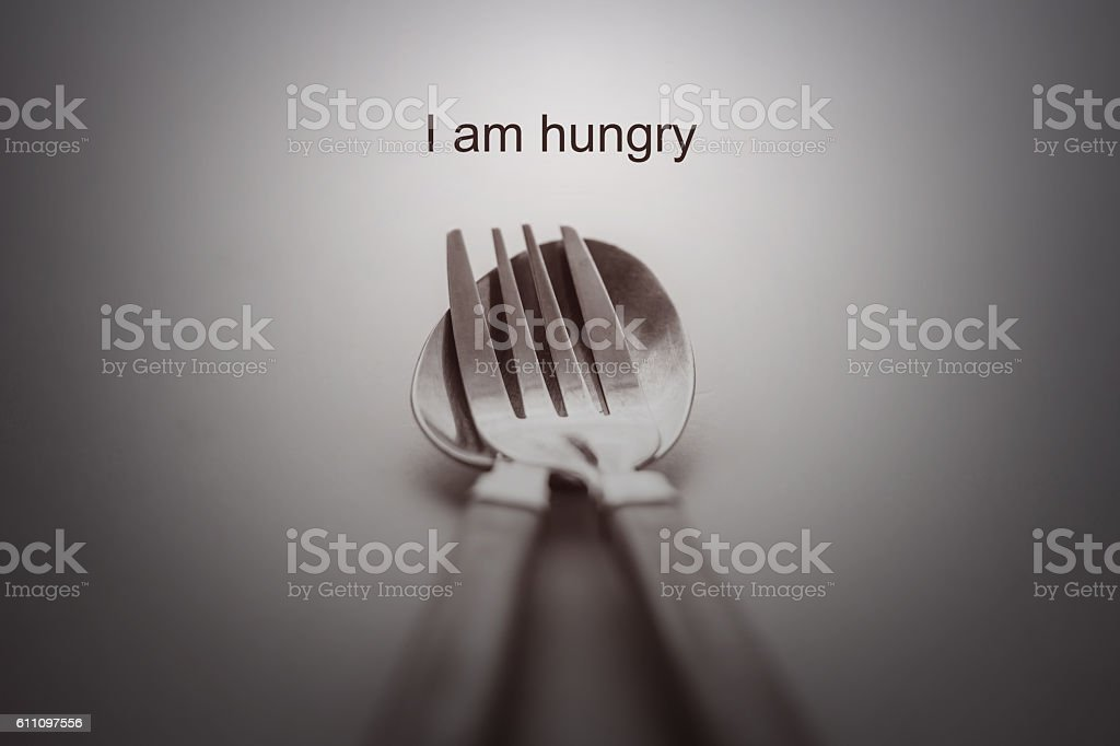 Fork and spoon on white background /i am hungry concept stock photo