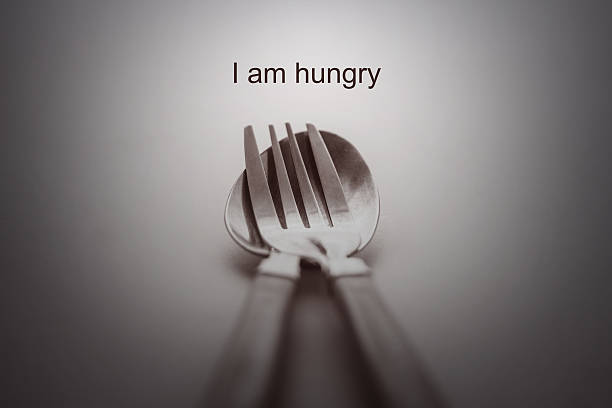 fork and spoon on white background /i am hungry concept - hungrig bildbanksfoton och bilder