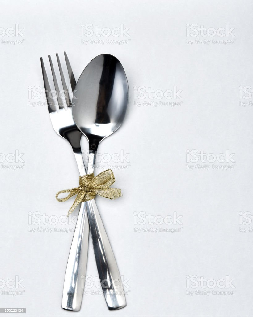 Fork and spoon with gold ribbon stock photo