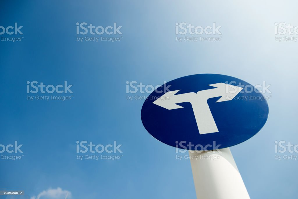Fork junction traffic sign and blue sky stock photo