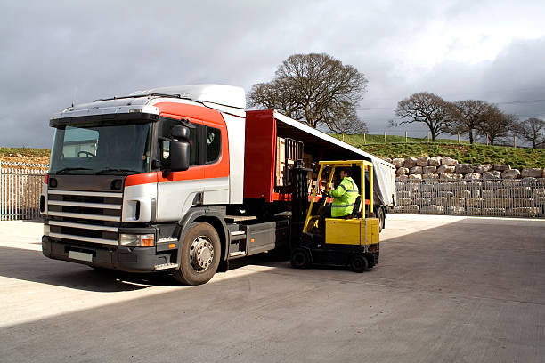 fork lift truck - lorries unloading stock photos and pictures