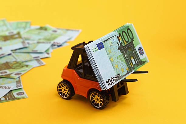 Fork lift truck with Euro Banknotes stock photo