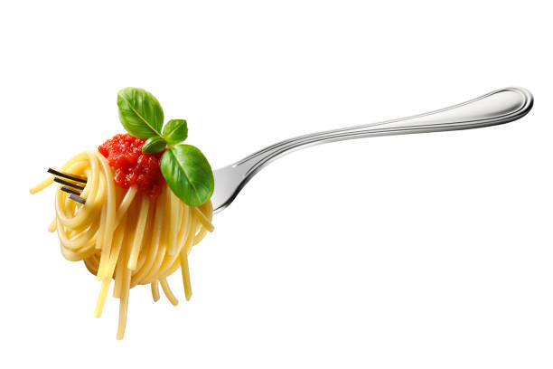 Fork of spaghetti with tomato sauce and basil Appetizing spaghetti rolled on fork with typical Italian sauce fork stock pictures, royalty-free photos & images
