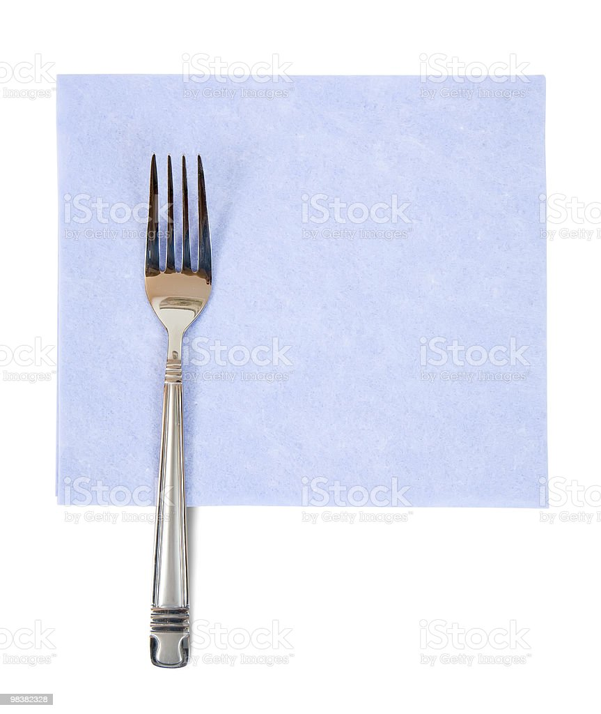 fork on blue napkin royalty-free stock photo