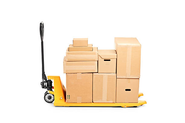Fork pallet truck stacker with many boxes A studio shot of a fork pallet truck stacker with many boxes isolated on white background pallet jack stock pictures, royalty-free photos & images