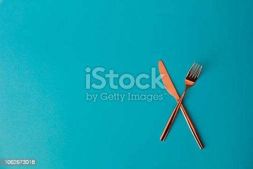 Fork sitting across a knife