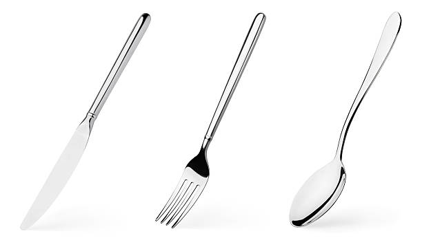 Fork, spoon and knife stock photo