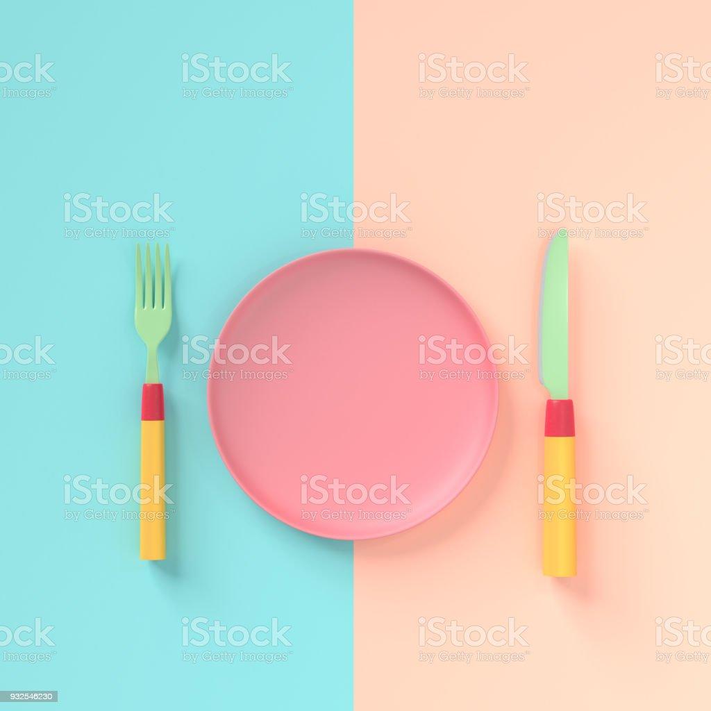 Vork met mes en plaat pastel kleur met kopie ruimte voor uw tekst foto