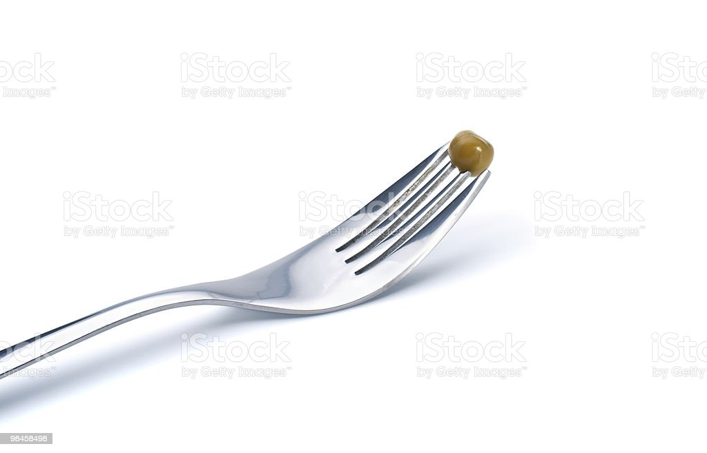 Fork with preserved pea royalty-free stock photo