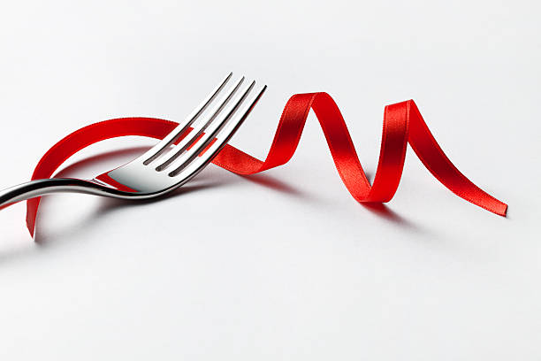 Fork with red ribbon stock photo