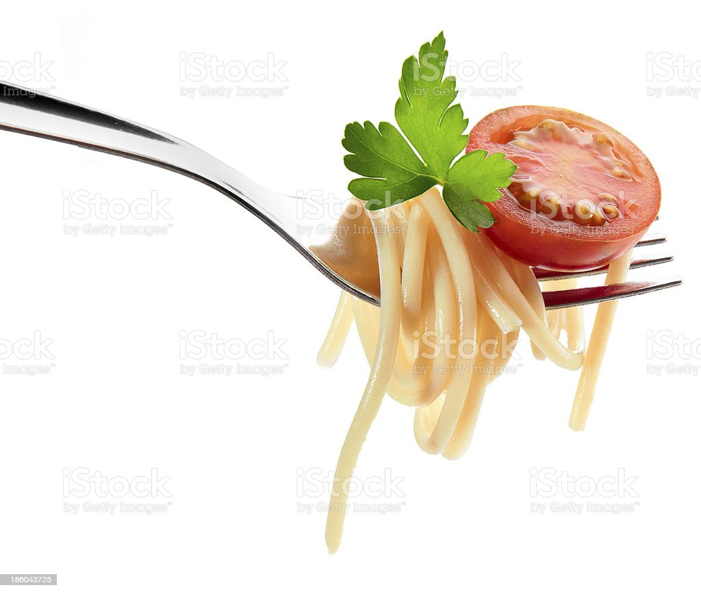 Fork with spaghetti and cherry tomato stock photo
