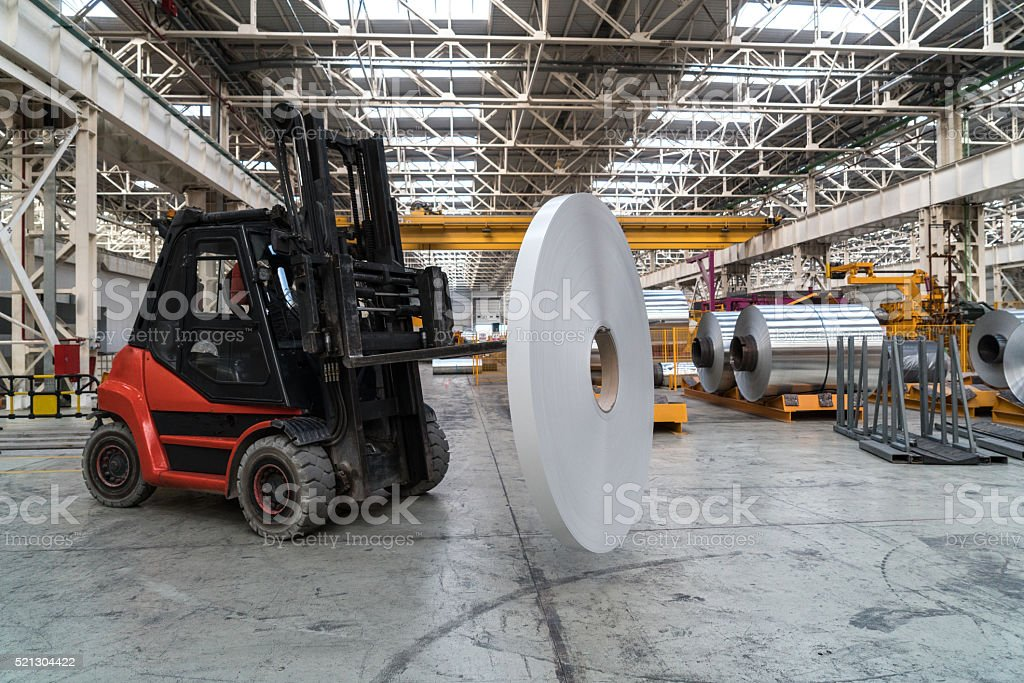 Forkflit carrying aluminium roll stock photo