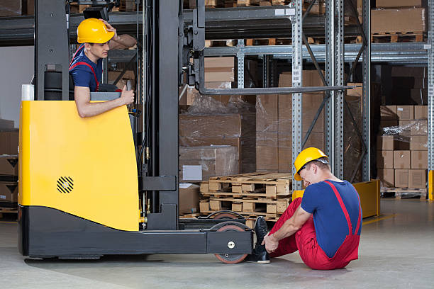 forklift accident in storehouse - impaired driving stock photos and pictures