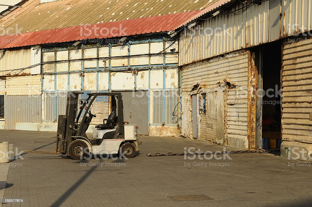 Forklift and warehouse royalty-free stock photo