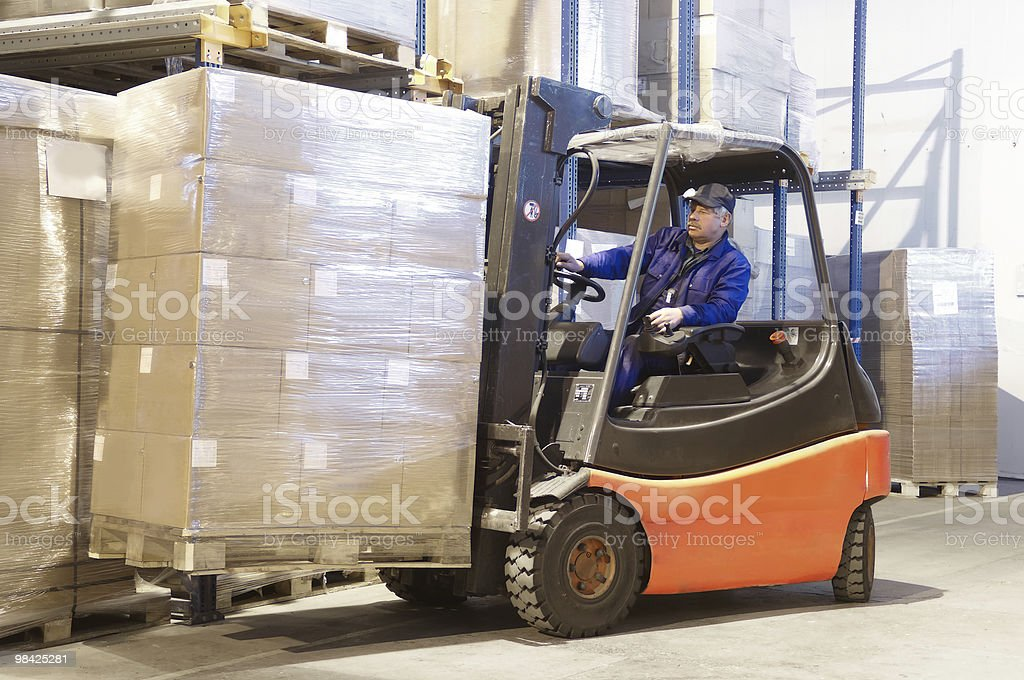 forklift at work with driver stock photo