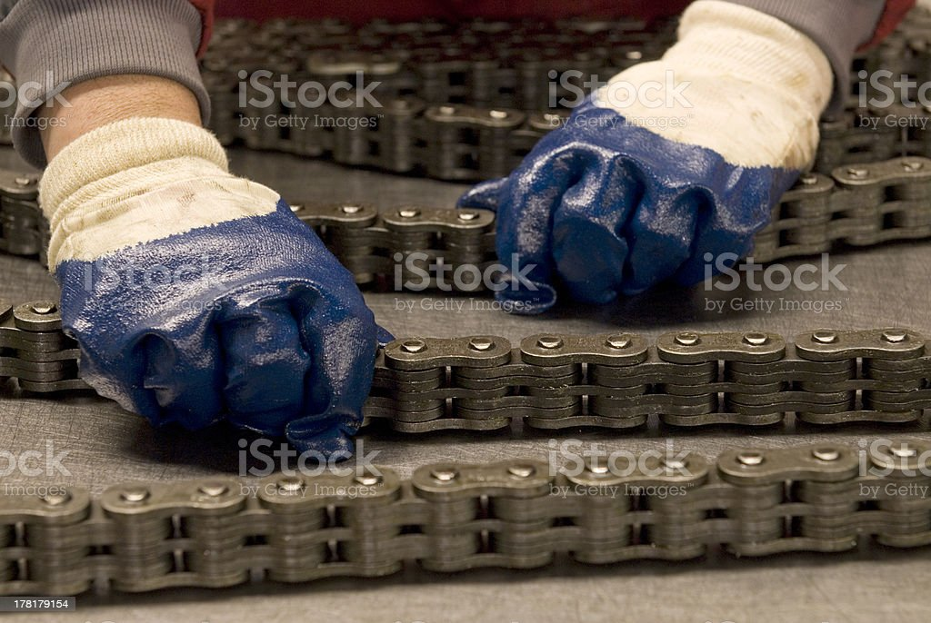 forklift chain being checked stock photo