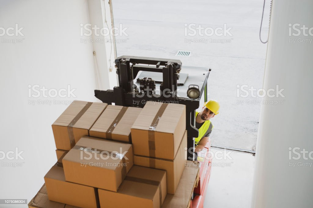 Forklift driver at warehouse stock photo