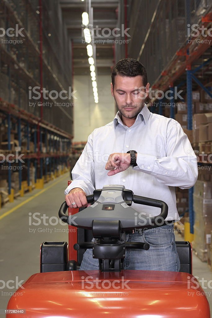 forklift driver checking time royalty-free stock photo