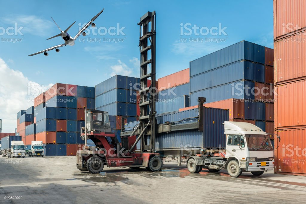 Forklift handling container box loading at docks with truck for Logistic Import Export concept. stock photo