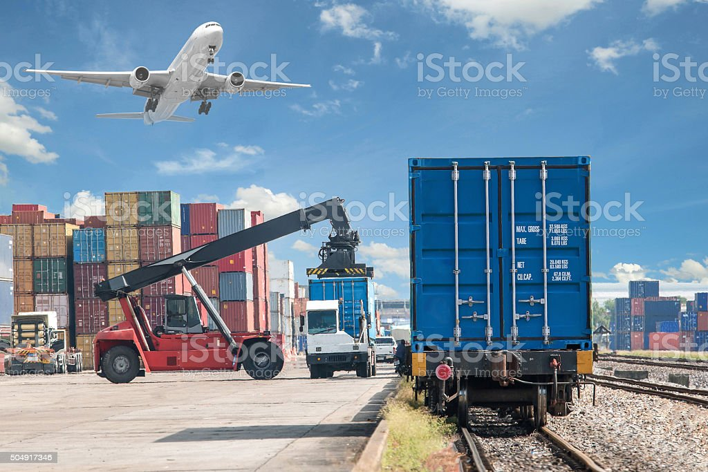 forklift handling container box loading to freight train - Royalty-free Airplane Stock Photo