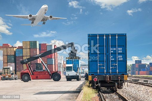 istock forklift handling container box loading to freight train 504917346