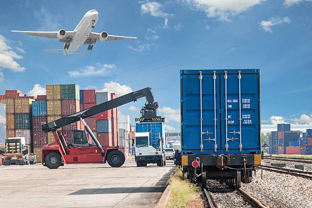 forklift handling container box loading to freight train stock photo