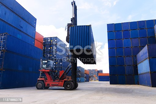 istock Forklift handling container box loading to freight trainer 1137886378