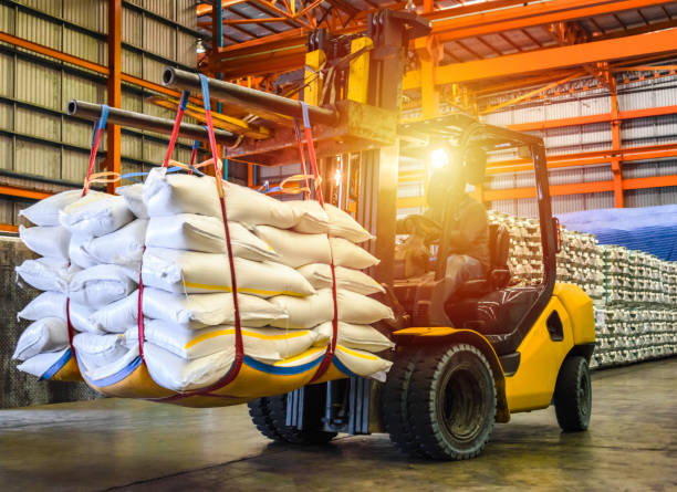 forklift handling sugar bags for stuffing into container for export. - material stock photos and pictures