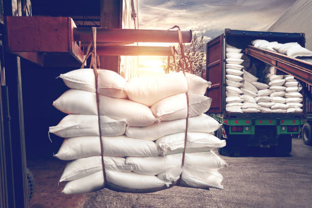 Forklift handling white sugar bags stuffing into a container truck Forklift handling white sugar bags from warehouse for stuffing into container truck for export, vintage tone. rice cereal plant stock pictures, royalty-free photos & images