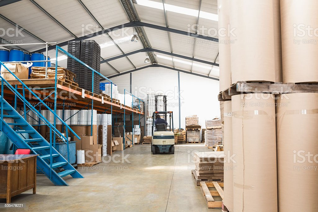 Forklift in a large warehouse stock photo