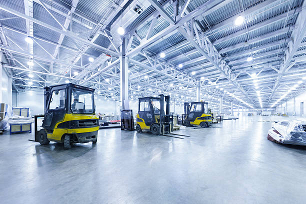 forklift in a warehouse - industrial modern stock photos and pictures