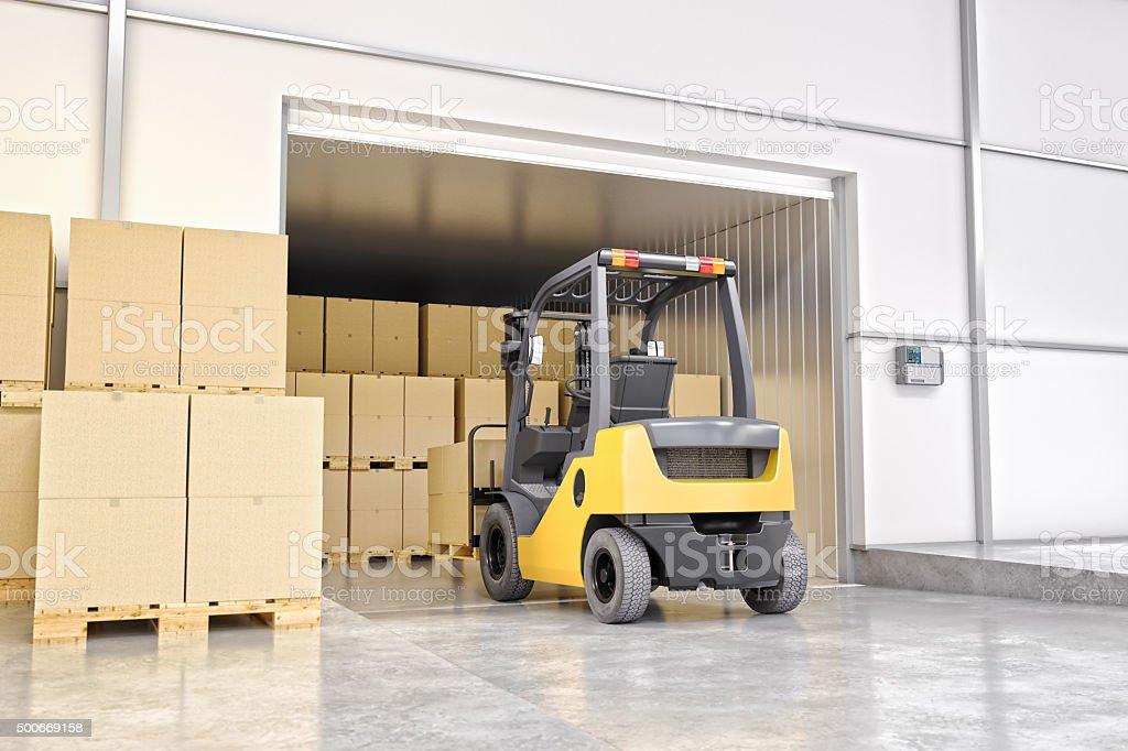 Forklift In Loading Bay Inside Of Warehouse stock photo