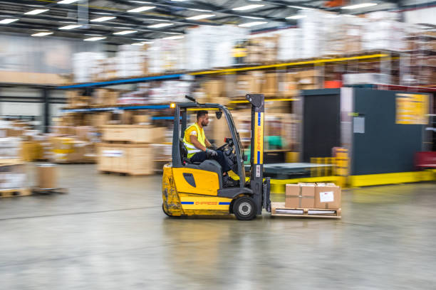 Forklift in warehouse stock photo