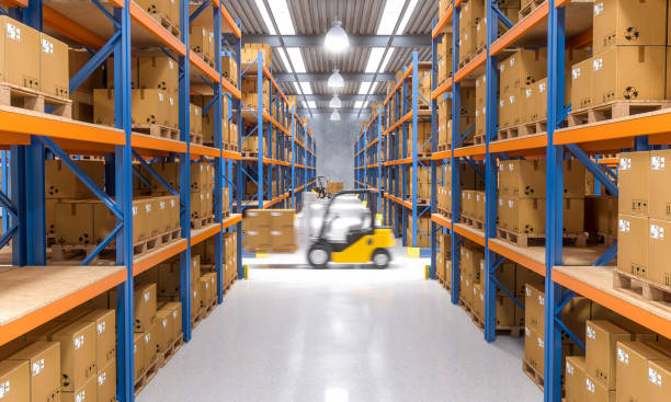 forklift in warehouse - warehouse stock photos and pictures