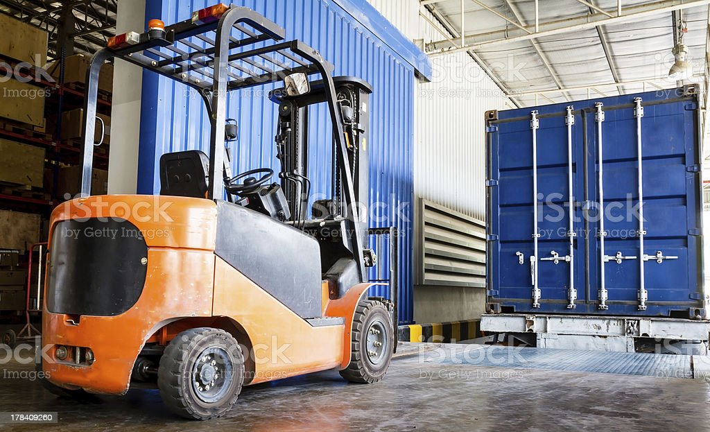 Forklift in warehouse with container stock photo