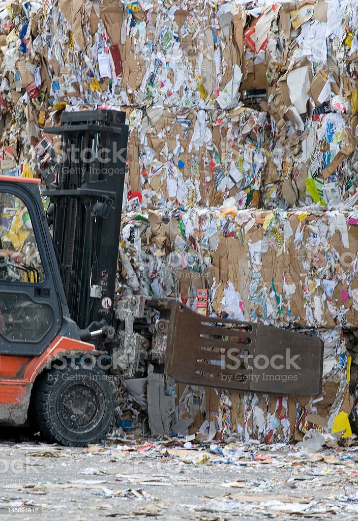 Forklift lifting cubes of recycled paper royalty-free stock photo