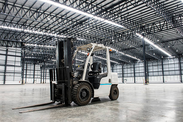 Forklift loader in large modern storehouse stock photo