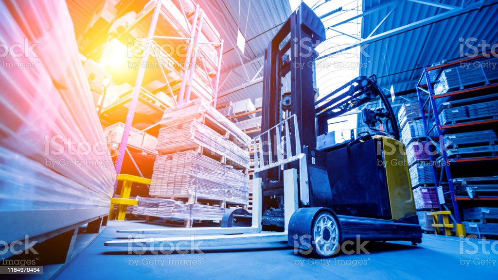 Forklift loader in storage warehouse ship yard. Distribution...