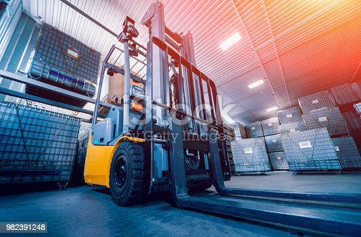Forklift loader. Pallet stacker truck equipment at warehouse. Background