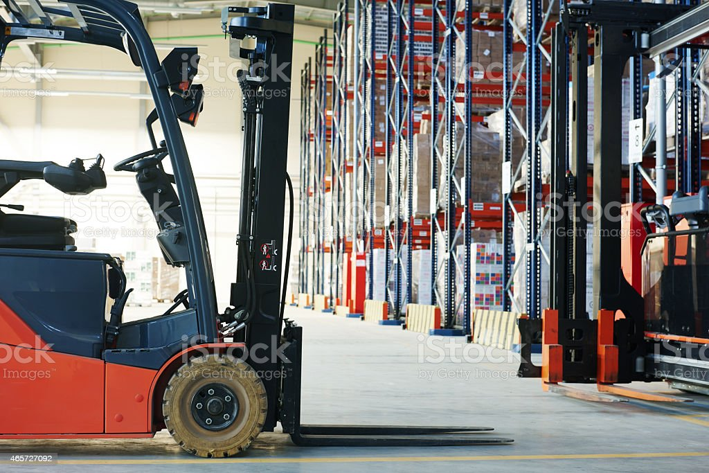 Forklift loader truck stacking crates at a warehouse forklift loader pallet stacker truck equipment at warehouse 2015 Stock Photo