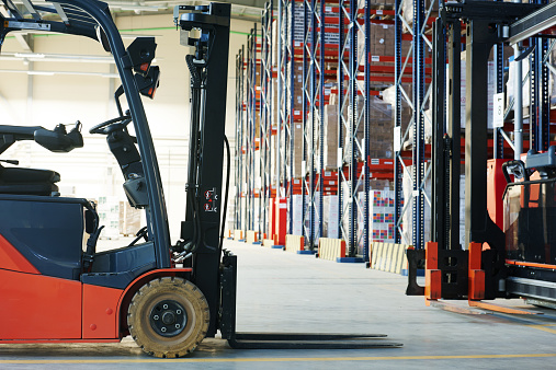 Forklift Loader Truck Stacking Crates At A Warehouse Stock Photo - Download Image Now