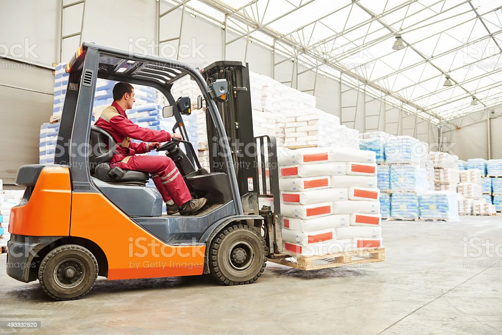 forklift loader working in warehouse stock photo