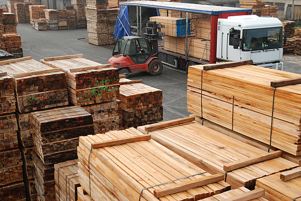 Forklift loading boards in a lumberyard stock photo