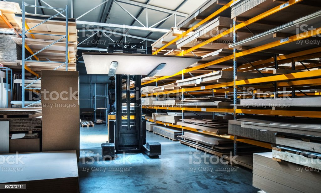 Forklift moving items at a warehouse. stock photo
