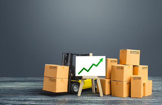 1155852718 istock photo Forklift near boxes and easel with green arrow up. Growth trade and production rates, increased sales. High import export. Economic growth, industry development. Marketing, price increases. 1208634902