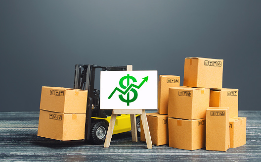 1155852718 istock photo Forklift near boxes and easel with green dollar arrow up. Growth trade and production rates, increased sales. Economic growth, industry development. Marketing, price increases. High import export. 1208453151