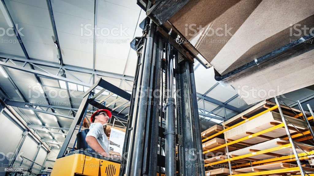 Forklift operator at a distribution warehouse stock photo